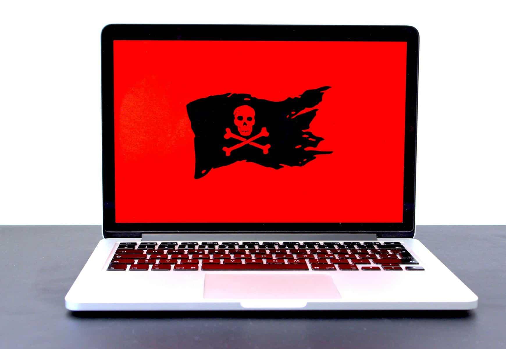 Laptop showing hacked screen
