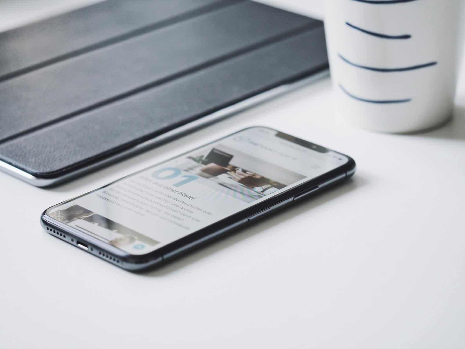Mobile phone on white desk