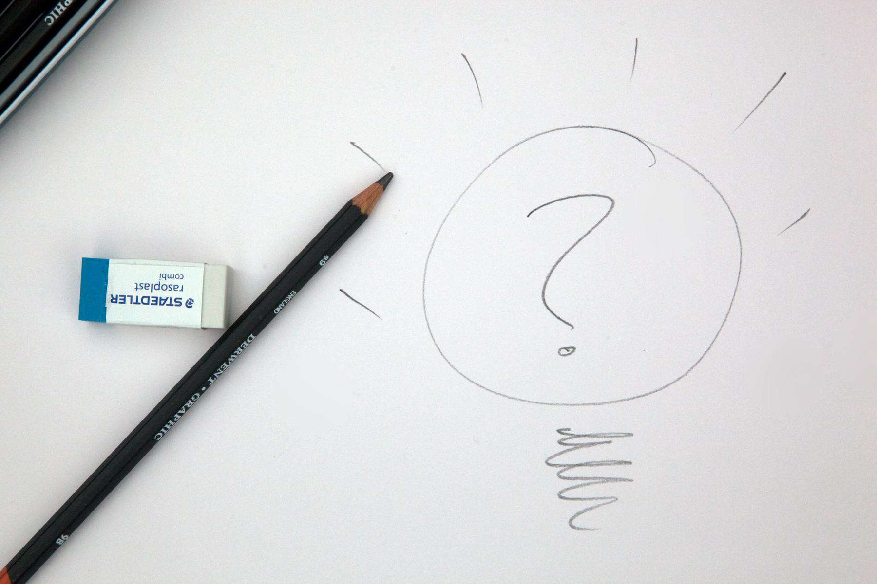 Question mark drawn on paper