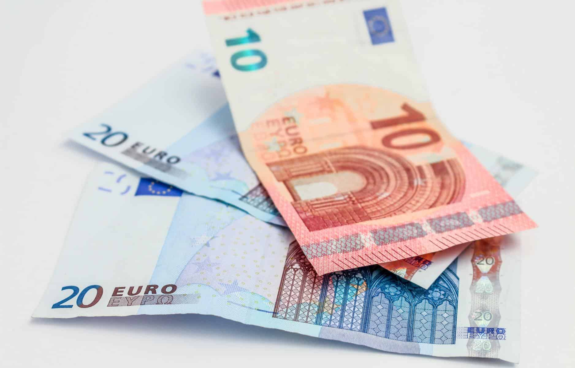 3 Euro banknotes on table