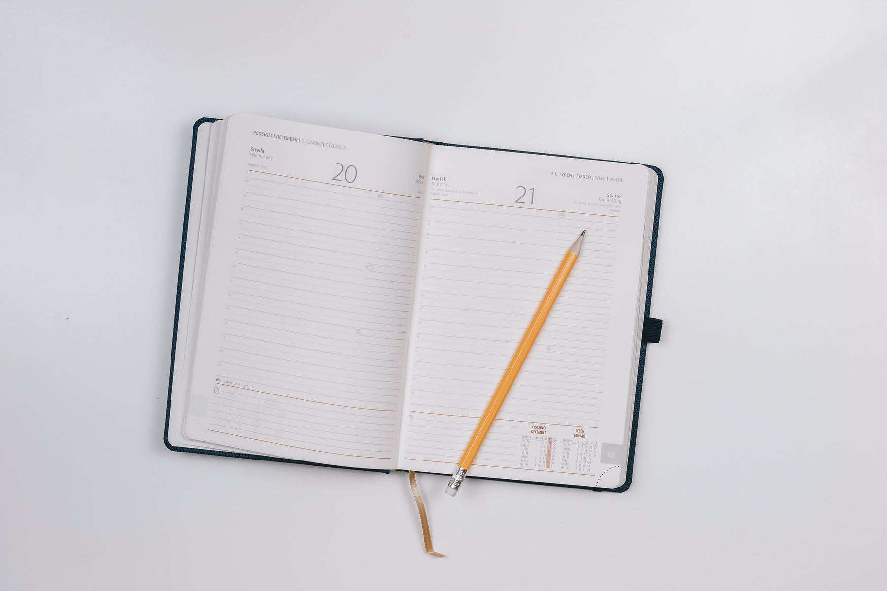 Open planner and pencil